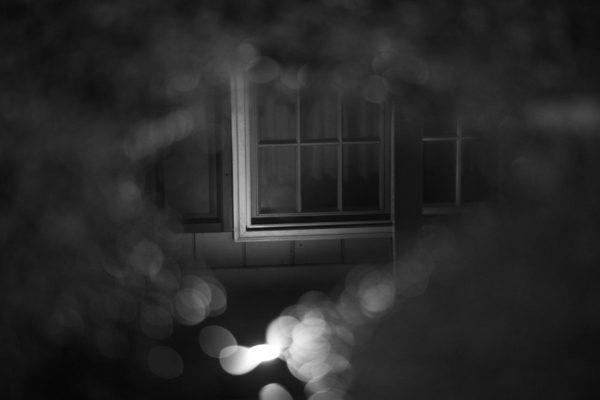 A photo of a window through a blurry surface
