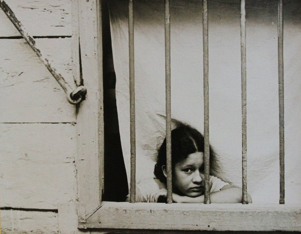 """Cuban girl looking through window bars."" 1933 by Walker Evans"