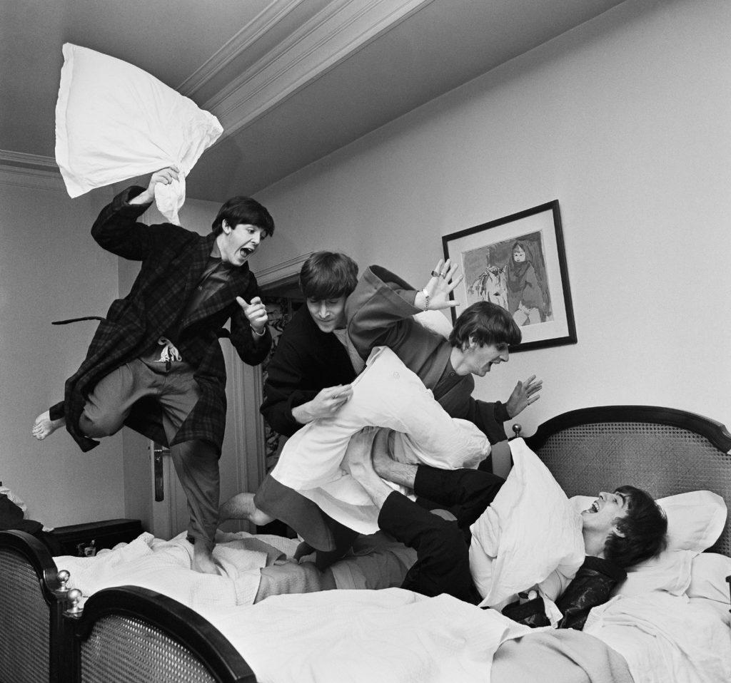 Photo of Beatles having a pillowfight © Harry Benson