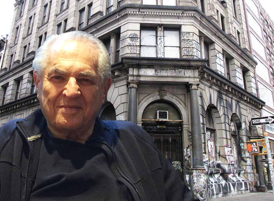 Photo of Jay Maisel in front of his former home on 190 Bowery