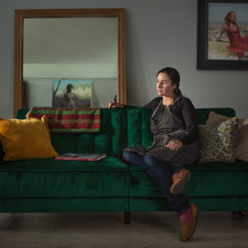 Portrait of a painter sitting on a couch